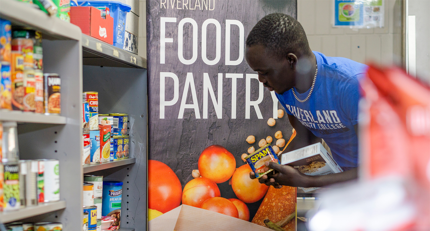 Riverland Student stocks the food pantry